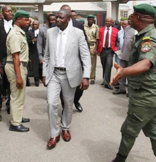 Former DG of NIMASA, Patrick Ziadeke Akpobolokemi (centre) being led out of court after his arraignment by EFCC in Lagos.