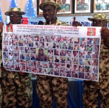 File Photo: Army Chief, Buratai displaying album of 100 most wanted Boko Haram terrorists