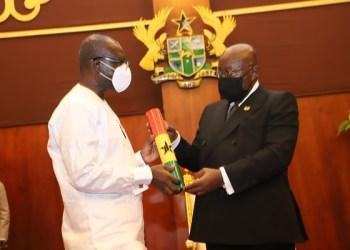 President Akufo-Addo (right) handing the instrument of Office to Mr Ken Ofori-Atta