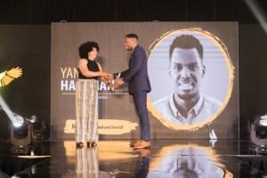 Yanfo-Hackman-receiving 40 Under 40 Award-636x424