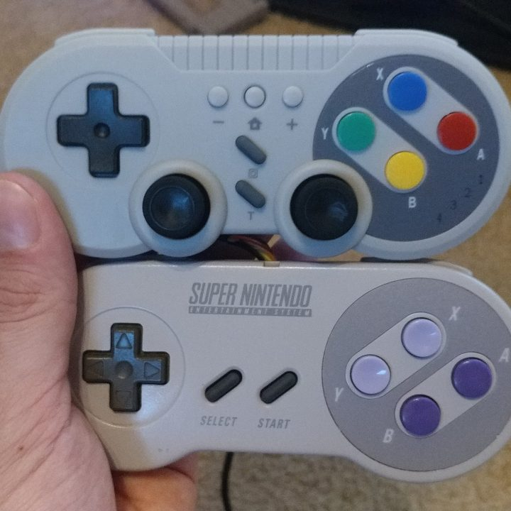Side-by-side comparison with the original SNES controller.