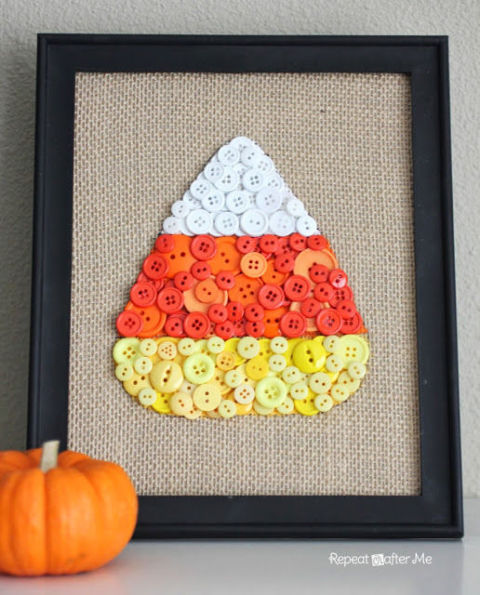 Forget about sewing — this blogger simply hot glued white, orange and yellow buttons to form this fun candy corn art. Get the tutorial at Repeat Crafter Me »