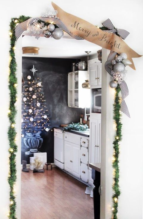 This blogger got into the spirit by drawing up a beautiful Christmas tree on her chalkboard wall (and we love her door-frame garland, too!). See more at Hunted Interior »