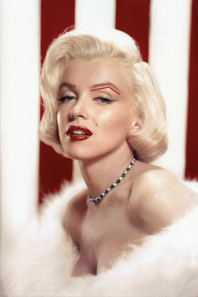 "Bombshell Marilyn Monroe is known for her voluptuous physique. What may be less obvious is that her soft curves extend to her face. ""She doesn't naturally have a very pronounced jawline or cheekbones,"" says New York City-based makeup artist and brow pro William Scott. That's where her hyper-defined brows come into play: Strong arches compensate for less-than-chiseled cheekbones. They add structure to her face, Scott says, and broadcast that this is one bombshell who calls the shots."