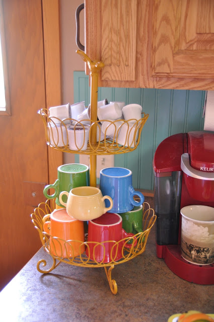 This tiered container takes coffee organization to the next level — it features a second basket to hold K-cups and creamers with your go-to mugs. See more at The Farmer and the Southern Belle »