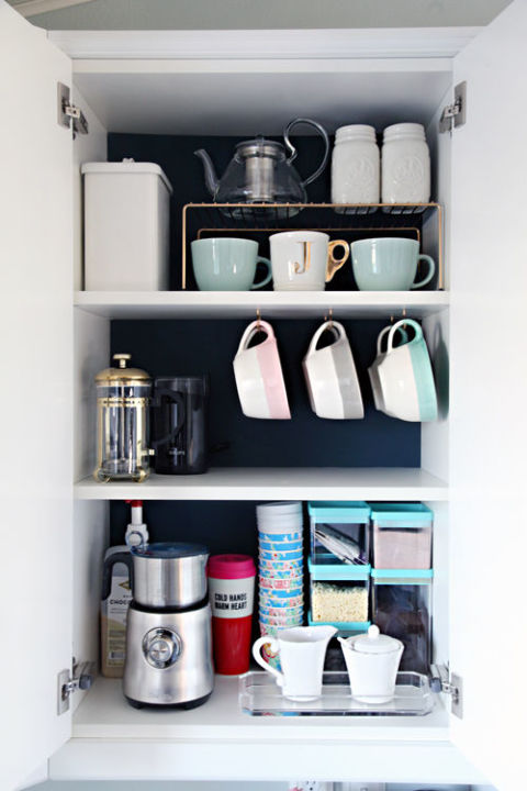 When you stack your mugs, you're basically asking for them to topple over and break. Add hooks to the bottom of a cabinet shelf to make it easier to grab cups in the morning. See more at I Heart Organizing »