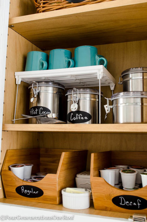 A free-standing shelf creates bonus cabinetry space. Stash your favorite beans or mix-ins (like sugar and cinnamon) underneath, that way all coffee essentials are within arm's reach.  See more at Four Generations One Roof »