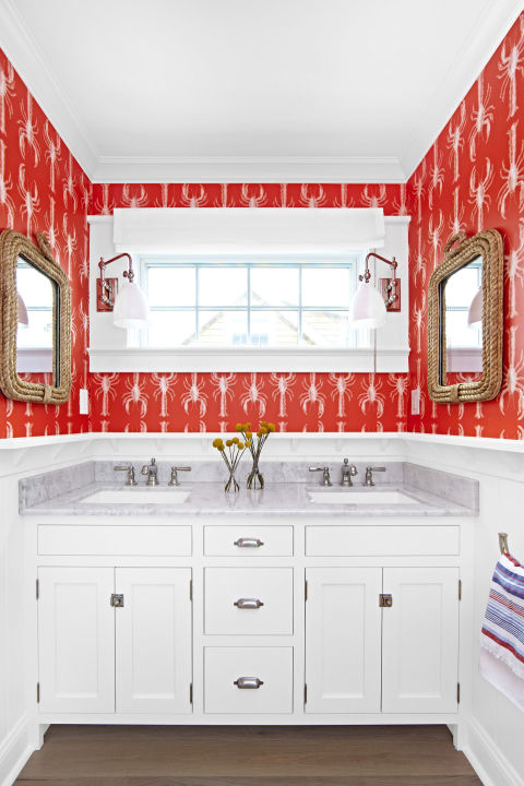 A small space has a secret advantage. Take the opportunity to use bold wallpaper that would overwhelm a larger room. This beach house bathroom features cheeky lobsters, but any favorite print will do.