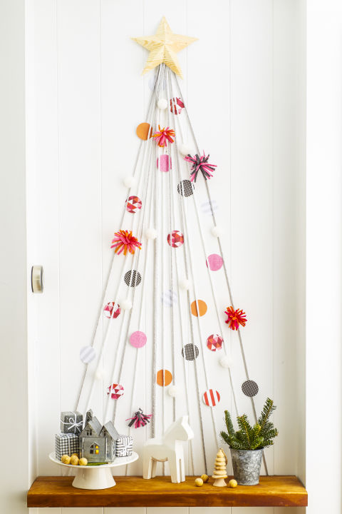 My favorite DIY Christmas Decor. DIY Christmas Decor Ideas. Use yarn to style a mini version on an empty wall or in a hallway. Enlist the kids to dress it to the nines with paper-circle