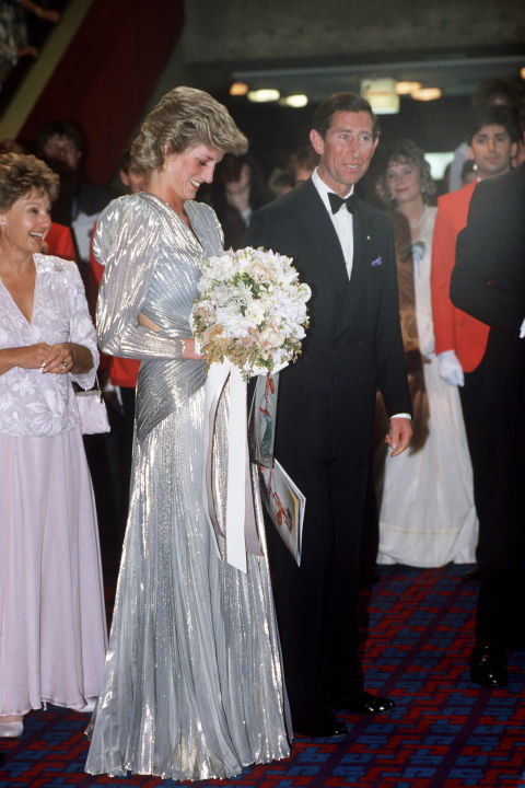 "The royal definitely embraced the broad-shouldered fashions of the day, including this backless lamé dress by Bruce Oldfield. The favored silhouette soon earned her the nickname ""Dynasty Di."""