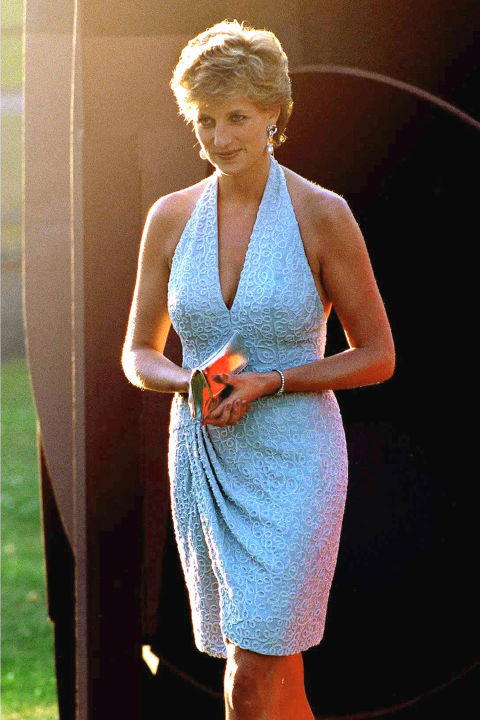 Another short style, this Catherine Walker halter neck dress featured glass beads embroidered in a scroll pattern. Diana wore the beaded shift to a gallery opening.