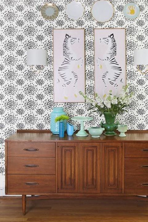 Create a stylish accent wall with a bold black-and-white pattern (this one is by American designer Albert Hadley). Pro tip: Use a stick-on paper to achieve this update in just one day. Get the look: wallpaper, $45, amazon.com
