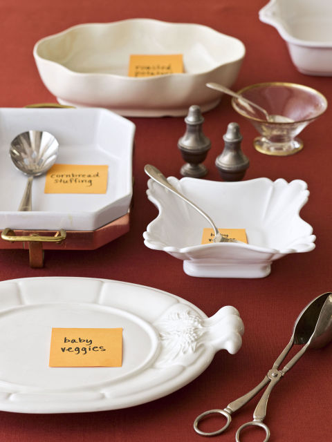 Before you begin baking and roasting, remove anything that's not Thanksgiving-related from your dining room. Then decide which Dutch oven, casserole dish, and servers will appear at the feast, and try them out on the table. Stick a note on each platter-and-utensil combo marking its purpose. You'll see what works where, and whether you're short on dishes and servingware. Plus, you'll avoid that last-minute scramble for a slotted spoon. To cut down on cleanup, pick bakeware that's nice enough looking to go from oven to table, or dress up plain pots by wrapping a festive tea towel around the base.