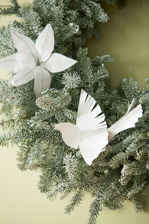 Adopt a white Christmas theme and keep things monochrome. The details on these folded doves pop even more in a neutral hue. Get the tutorial » What you'll need: pinecones ($9, amazon.com), snow spray ($10, amazon.com)