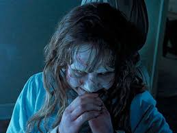 Film Still from The Exorcist of Regan laughing