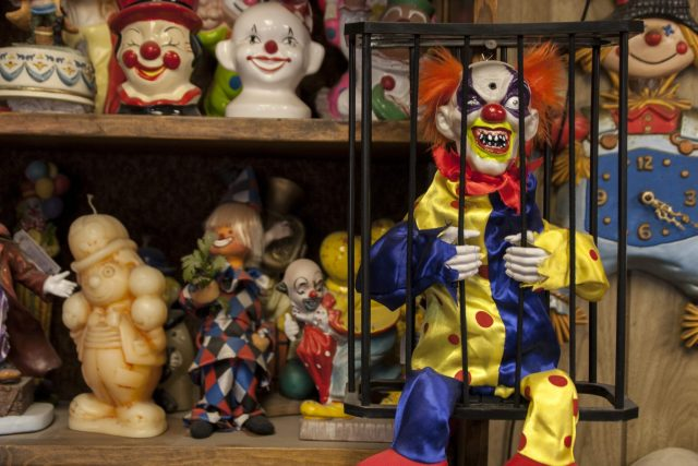 One of the potentially haunted clowns at the Clown Motel. An evil looking clown in a cage