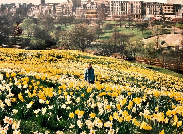 Rebecca Standing in a field of flowers outside of Edinburgh Castle, Scotland Photo Credit: Rebecca Rivers