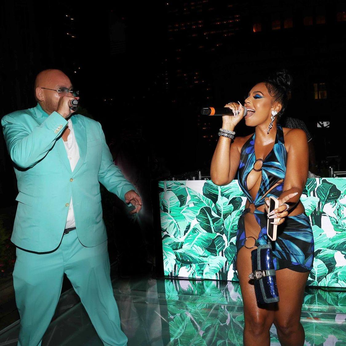 Wardrobe Inquiry Most Requested: Ashanti Performs at Fat Joe's Birthday in Louisa Ballou Cut Out Ring Blue Print Dress