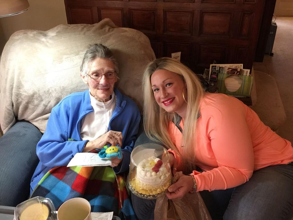 Liz presents Bev with her favorite lemon cake!