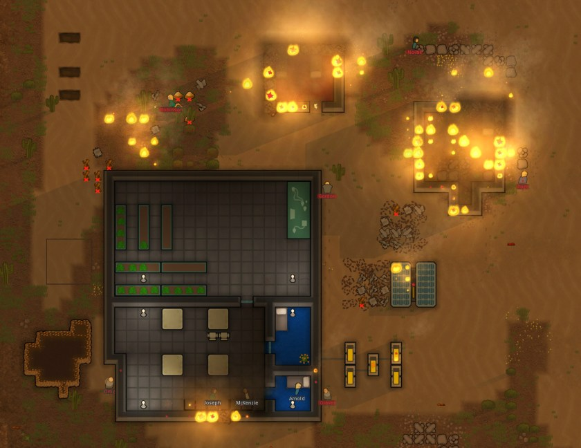 A Rimworld colony is burning from out of control flames.