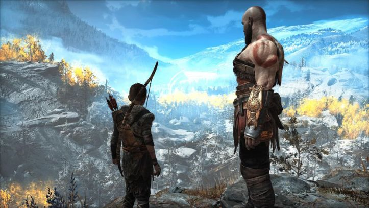 Kratos and Aterus overlook a snowy landscape in God Of War