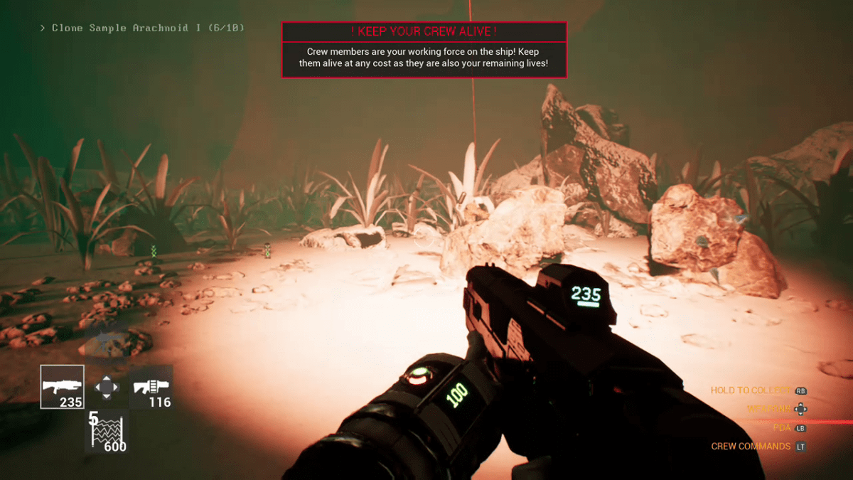 The player looks for danger on a planet under the red light of the drop ship in Genesis Alpha One.