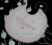 Fiocco nascita carrozzina, bavetta prima misura e bomboniere porta confetti carrozzina per Chiara