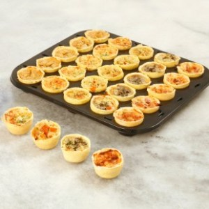 Party Foods. Image showing tray of Canape Quiches
