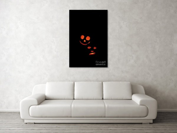 Halloween black and orange funny poster over the living-room sofa