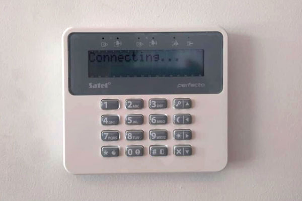 intrusion control panel installed at a wall