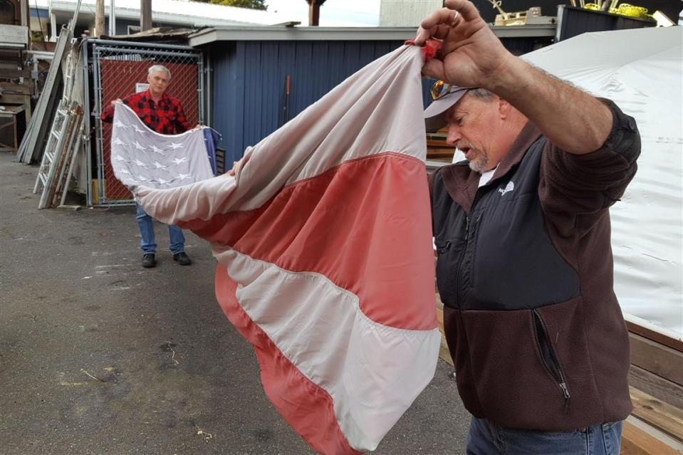 flag lowered and folded