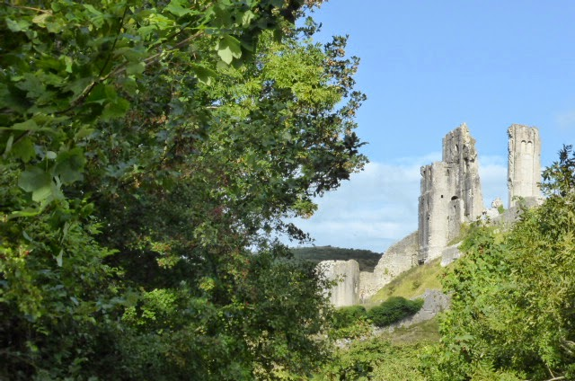 Corfe Castle from a quiet leafy lane.