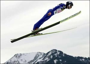 ski jumper flying in the air