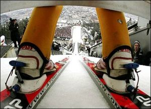 sitting at the top of the ski jump