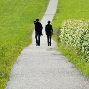 man and woman walking away