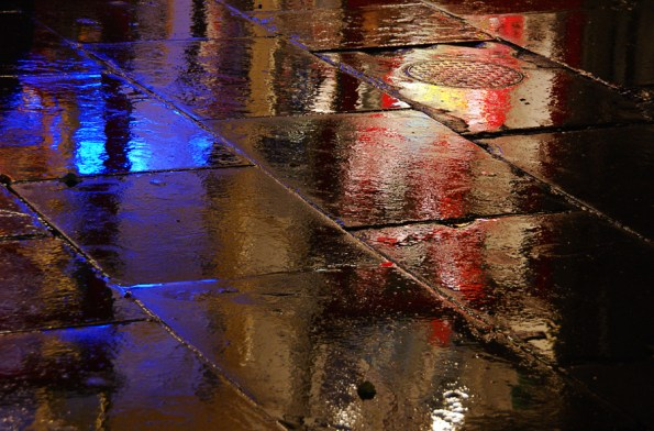 Wet pavement with lights