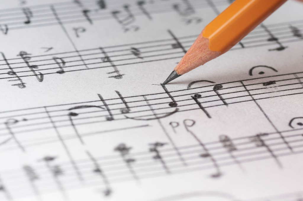 Writing music notes with a graphite pencil