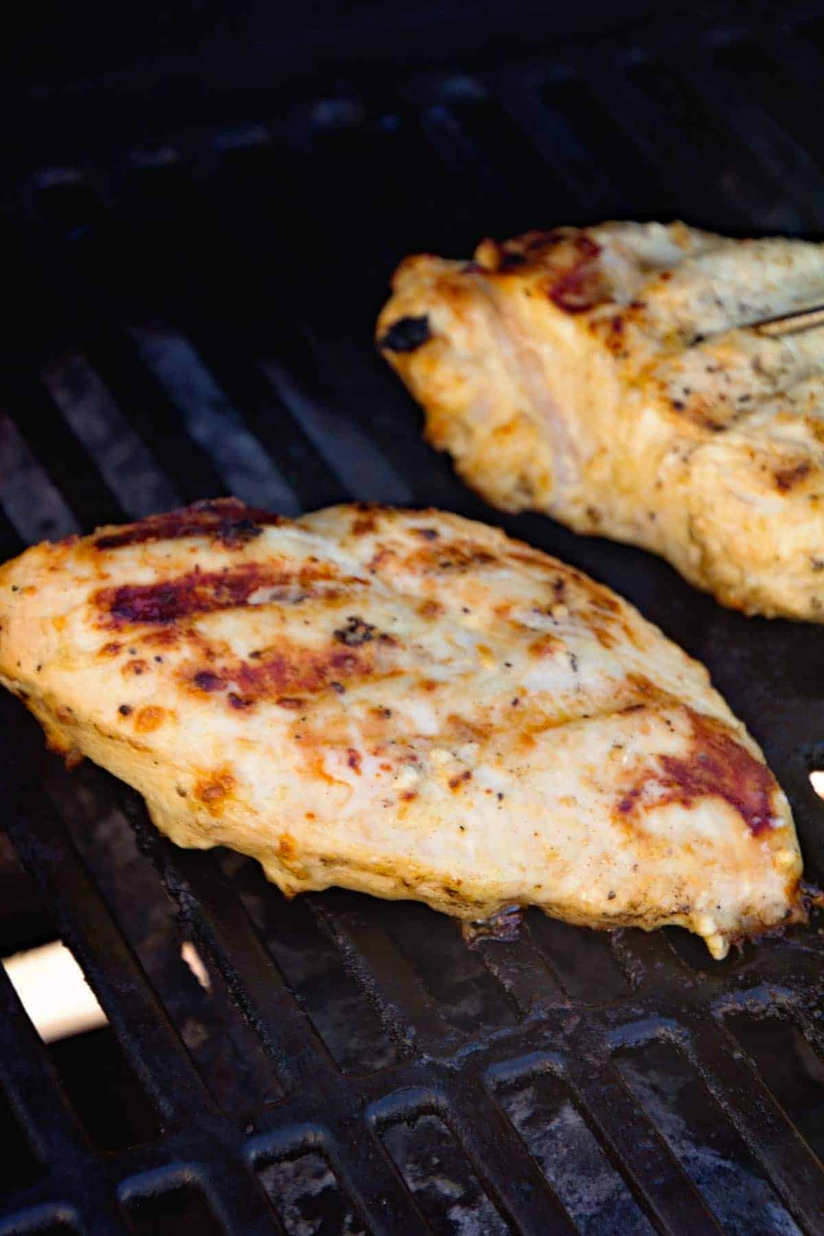Grilled Caesar Chicken breasts on grill