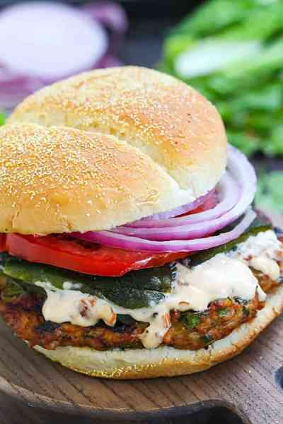 Chicken fajita burger on cutting board