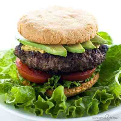 Hamburger with avocado, tomato, and lettuce