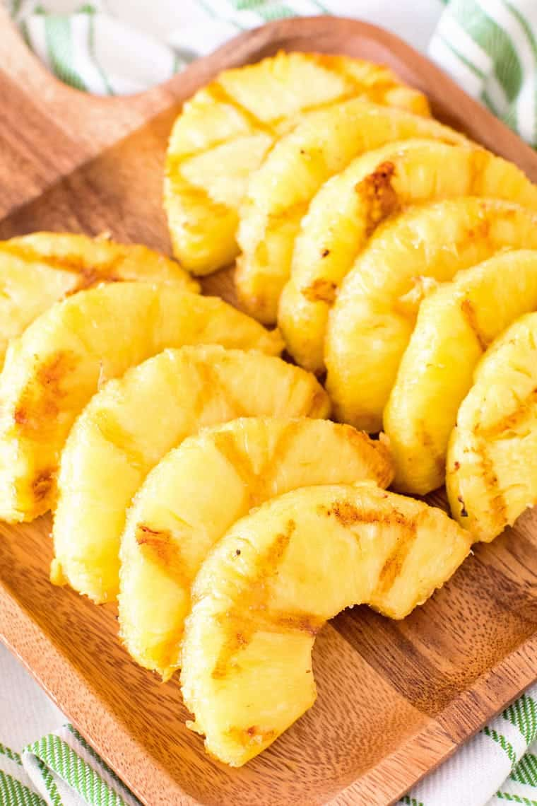 grilled pineapple slices on cutting board