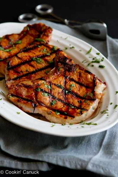 grilled pineapple chili pork chops on plate