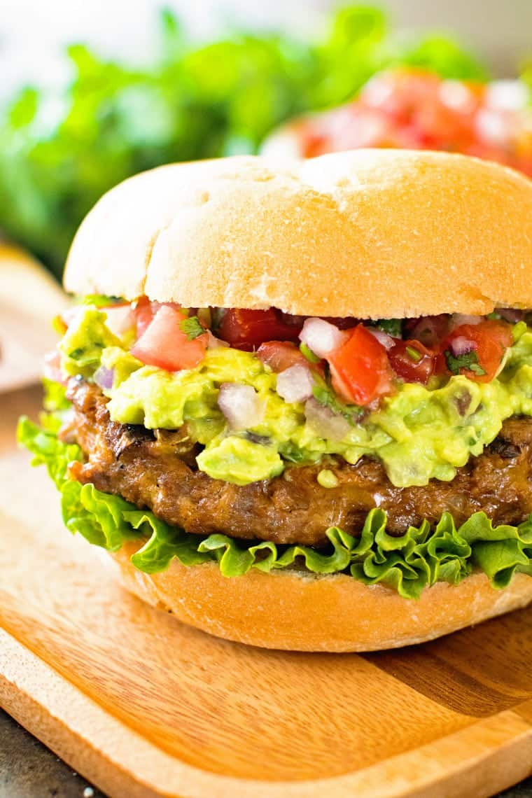Burger with pico de gallo and gaucamole on board
