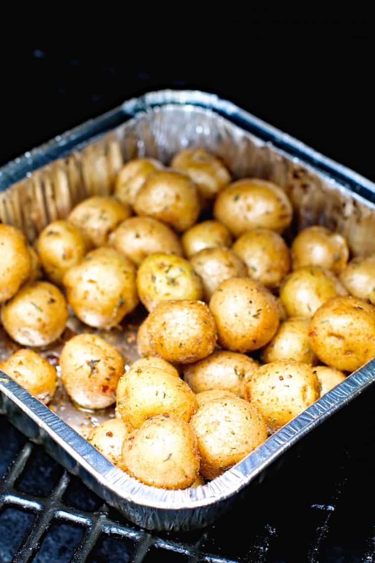 Potatoes in foil pan on smoker