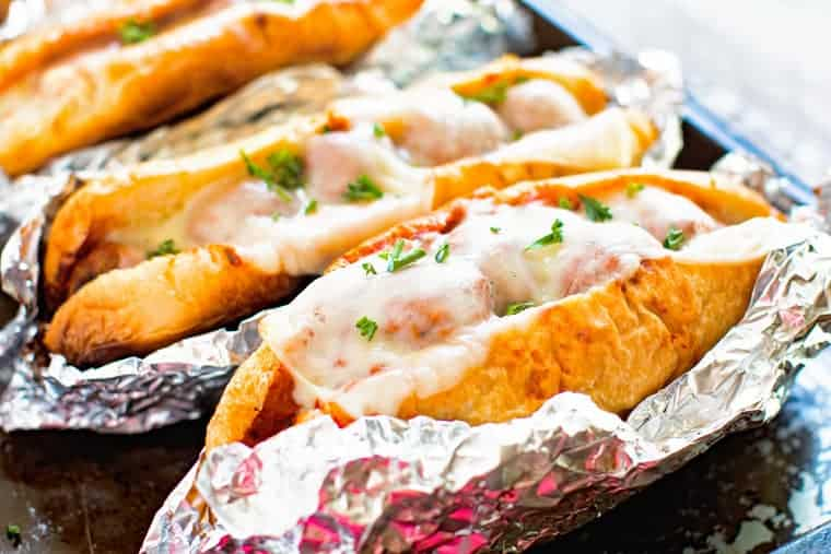 Meatball sub sandwiches in foil wrap