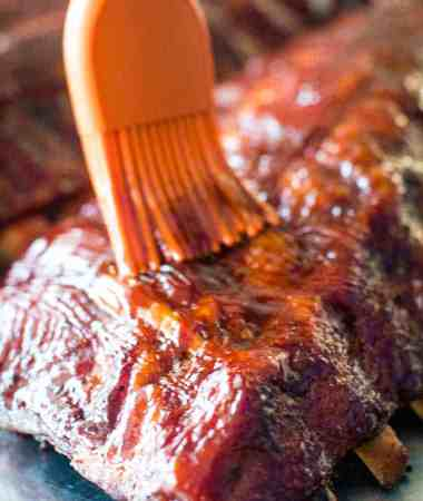 Easy Smoked Ribs being brushed with BBQ sauce