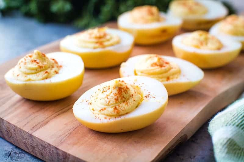 Wood plank with prepared smoked deviled eggs