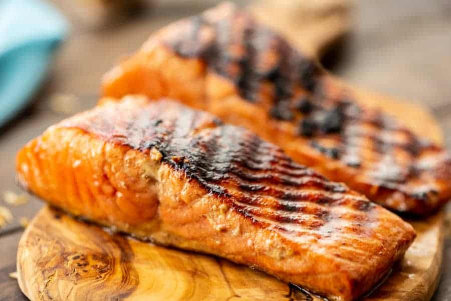 Easy Salmon on the Grill on a wood board