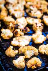 Grilled cauliflower on a black tray