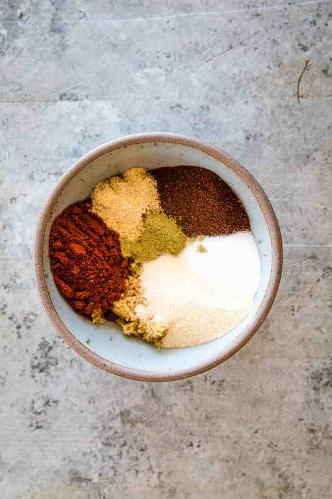 Overhead image of a gray bowl of seasonings before mixing